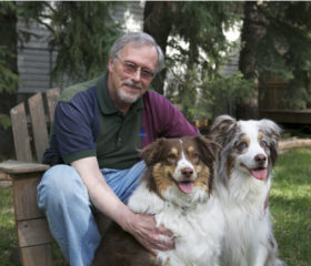 Dr. John Pharr with his two Australian shepherds, Booster (left) and Brodie. Photo: Myrna MacDonald.