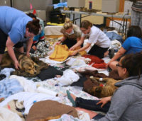 """CAP team members monitor their patients in the clinic's temporary """"recovery area."""""""