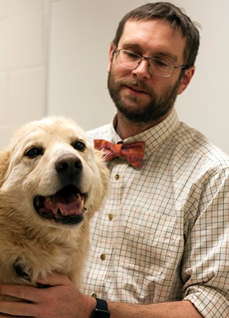 Beef with his owner Dr. Chris Clark. Photo by WCVM Today.